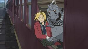 Ihmishahmo ja robotti matkustavat junassa ja katsovat avoimesta ikkunasta ulos.