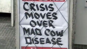 "En planch var det står ""CRISIS MOVES OVER MAD COW DISEASE"""