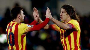 Messi och Puyol firar segern mot Getafe.