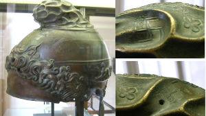 en gammal grekisk hjälm i brons med svastikasymboler på sig.