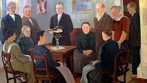 Eero Nelimarkka: Hartaushetki Alaviitalassa (1924), öljyvärimaalaus pellavakankaalle, 145 x 210 cm.  Pappi pitää hartaushetkeä.