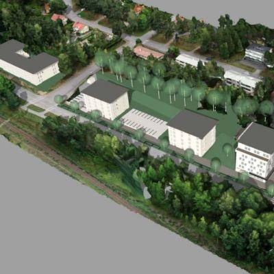 Ritning över fyra nya byggnader i flera våningar.