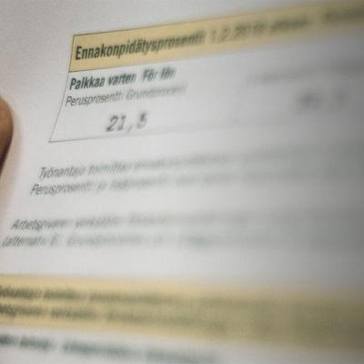 Ett skattekort som visar grundprocent för lön.