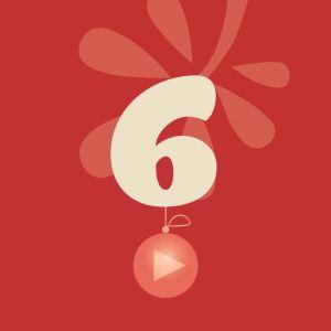 Joulukalenterin luukku, punaisella taustalla numero 6.