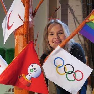 Malin bland olika flaggor