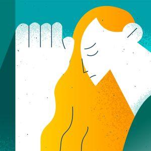 Piiroskuva surullisesta naisesta, jolla on oranssit pitkät hiukset.