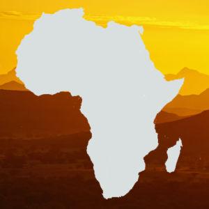 Kuvassa on Afrikan manner ja taustalla vaaleanruskea maisemakuva.