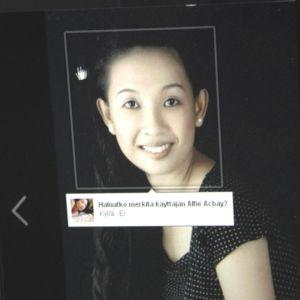 kuva nuoresta filippiiniläisnaisesta tietokoneen ruudulla