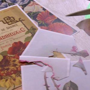 Camilla klipper ut rosor och fåglar