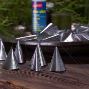 Silverklockor färdiga att hängas upp.