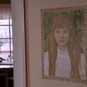 Larssons barn avporträtterade i hemmet.