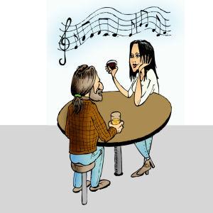 Man och kvinna sitter vid ett bord och lyssnar på musik
