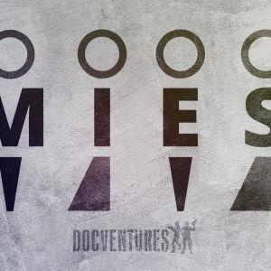 Mies logoina ja kirjoitettuna tekstinä