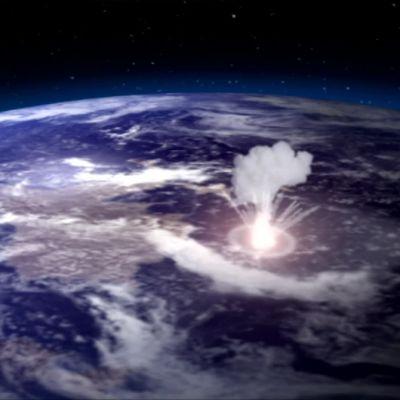 En meteorit slår ner på Jorden.