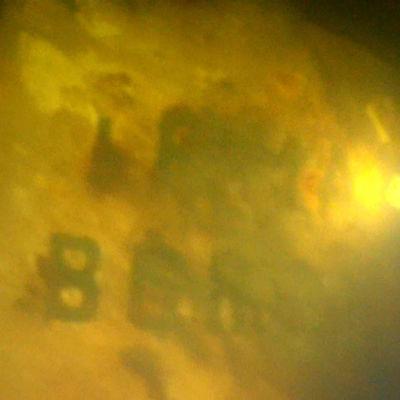 """Undervattensbild med detalj på m/s irma. Texten """"Irma samt Borgå"""" syns."""