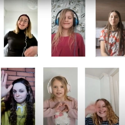 Tyttökuoro Vuoksen Neiet -esiintyy videolla.