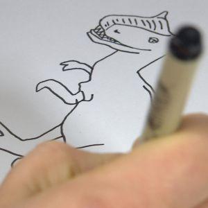 Närbild av tecknad dinosaurie.
