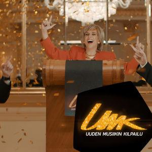 Presidentti Siegfrids kreisibailaa konfettisateessa - ruutukaappaus videolta