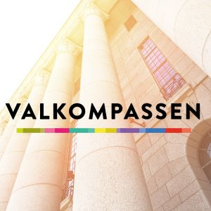 Svenska Yles valkompass på en mobilskärm med riksdagshuset i bakgrunden.