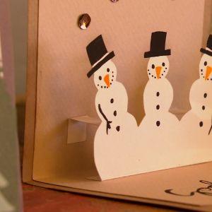 Julkort med snögubbar.