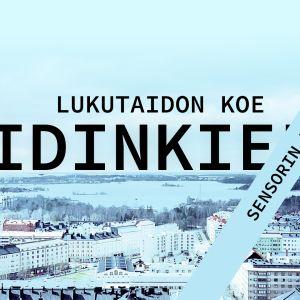 Talvinen kaupunkimaisema, jonka päällä tekstit, lukutaidonkoe, äidinkieli, sensorin vinkit
