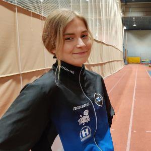 Jenna Kokkonen juoksuradalla.