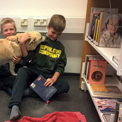 Library dog Hilma with Samuel Fors and Pontus Engdal in Kimito, Southwest Finland