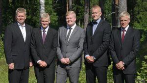 Bröderna Sjöman med pappa.