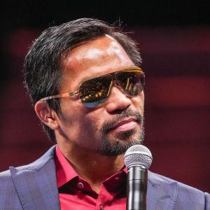 Boxningsstjärnan Manny Pacquiao har utsetts till en av det styrande partiets två presidentkandidater i presidentvalet i Filippinerna nästa år.