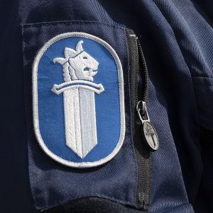 Närbild på en polisuniform.