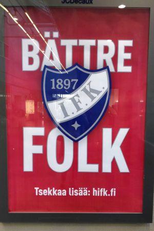 En affisch med texten Bättre folk och ishockeylaget IFK från Helsingfors blåvita logo med texten IFK och årtalet 1897.