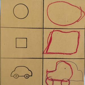 Ylhäältä alas oikealla ympyrän, neliön, auton ja kerrostalon ääriviivat, vasemmalla puolella lapsen piirtäminä samat kuviot.