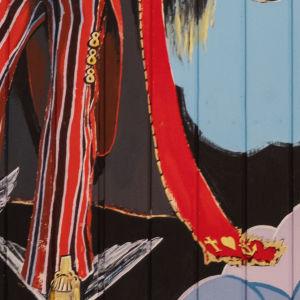 Jeesus kuvattuna punaisessa puvussa, raidalliset housut, kädessä nuottiavain, lahkeessa kolme kahdeksaa, takin liepeessä usko, toivo ja rakkaus