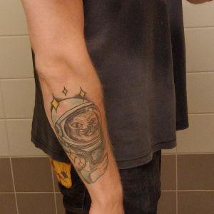Tatuering av en kattastronaut