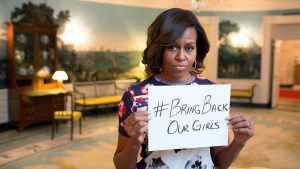 "Michelle Obama tweeted a photo that shows the First Lady holding a sign that says, ""#BringBackOurGirls,"" in reference to the missing Nigerian schoolgirls, on May 7, 2014."