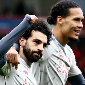 Mohamed Salah och Virgil van Dijk jublar.