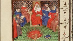 Reproduktio keskiaikaisesta käsikirjoituksesta: Caleruejan pyhä Dominik ja legenda kirjasta, joka ei pala.