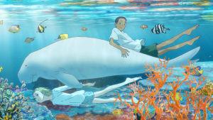 Children of the sea -elokuvan kohtaus, jossa poika ratsastaa valaalla veden alla.