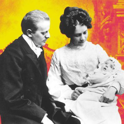 Aviopari, äidin sylissä vauva kastemekossa.