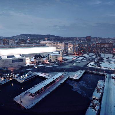 Havainnekuvassa Oslon uusi Kansallismuseo talvi-iltana.