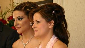 Libanonilaiset morsian ja kaaso, originaalikuvan taustalla mieshenkilö.