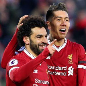 Mohamed Salah och Roberto Firmino firar i Liverpool.