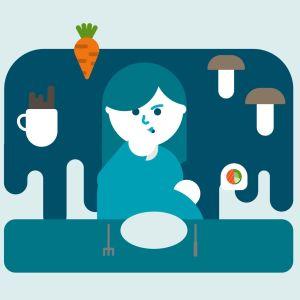 En gravid kvinna sitter vid ett matbord, omgiven av olika livsmedel.
