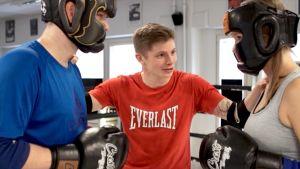 Bild på robban nilsson, johan lahti och Sonja kailassaari i boxningsringen