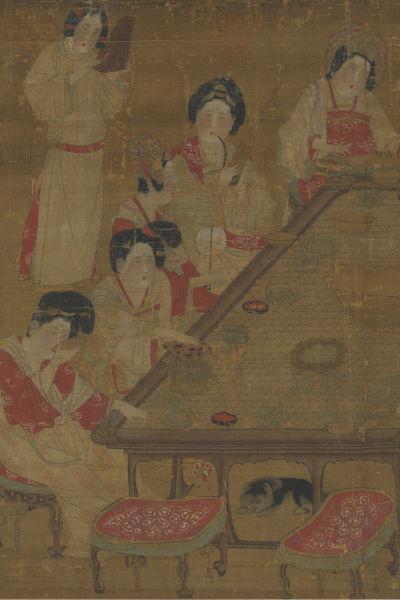 Kiinalaisia hovinaisia ja pöydän alla koira