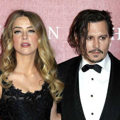 Amber Heard ja Johnny Depp.