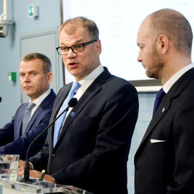 Petteri Orpo,Juha Sipilä ja Sampo Terho.