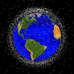 maapallo, jonka ympärille merkitty avaruusromun kappaleet pisteinä