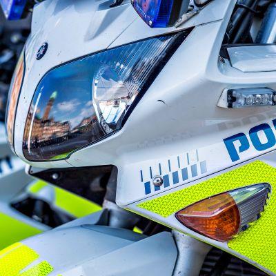 Tanskan poliisin logo moottoripyörissä.