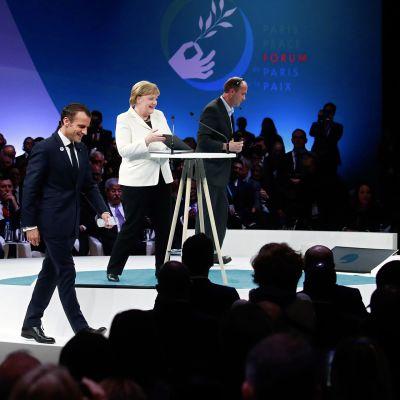 Emmanuel Macron ja Angela Merkel avasivat rauhanfoorumin Pariisissa.